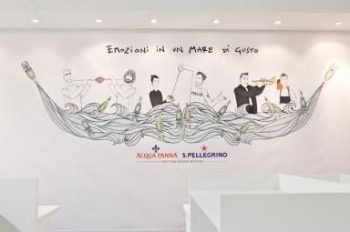 Nello stand, l'illustrazione di Gianluca Biscalchin con le coppie protagoniste degli incontri organizzati alla tavola di Acqua Panna e S.Pellegrino durante il congresso