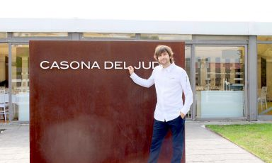 Sergio Bastard in front of the entrance to his re