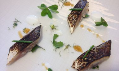 Roasted mackerel with red garlic sauce, acid emulsion and wild herbs by Nicola Fossaceca of Al Metrò in San Salvo (Chieti), one Michelin star