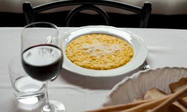 Saffron risotto, an absolute symbol of milanese cuisine, here in a Masuelli San Marco's restaurant pitcure. It is one of the most historic and traditional places in the city