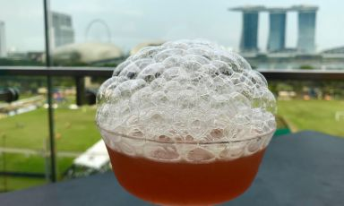 Drink (Old & New Sling atSmoke & Mirrors) with a view of Singapore. The city-state charms with its magnificent cocktail bars