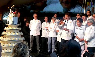 Enrico Cerea on stage with the cake for Da Vittori