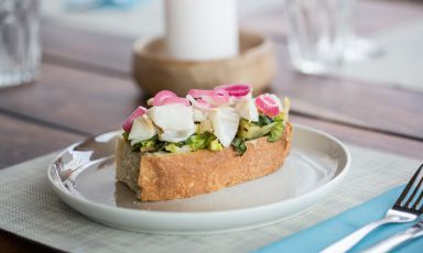 Gunnar Jensen's new restaurant in Trømso, called Mathallen, where you can taste an interpretation of Danish Smørrebrød, prepared with codfish placed on a slice of focaccia, with shallot and red onion purée