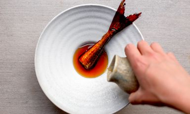 Garfish tail – a food scrap – glazed with soy sauce, with a broth made from the head and bones of the garfish - a food scrap - in infusion with katsuobushi made with mackerel bones – a food scrap – and a brine of lemon scrap. No waste as interpreted by Valerio Serino from Tèrra in Copenhagen