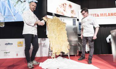 Riccardo Camanini, his sousGilles Fornoniand sbernia [sheep's meat] covered in beeswax at Identità Milano 2018(photo Brambilla-Serrani)