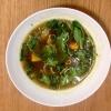 Brodo vegetale ricavato da funghi, lime bruciato e tostato e servito con cipolle, zucca, zucchine ed erbe aromatiche (basilico, alloro, timo)