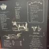 La lavagna del menu del ristorante Kobe Plaisir, un inno alla carne più ambita del mondo