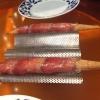 """Airbaguette de rubia gallega: grissino-baguette vuoto avvolto da fettine di """"prosciutto"""" marinatodirubia gallega, pregiata razza bovina galiziana"""