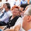 Annie Féolde seduta tra il pubblico