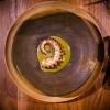 Il polpo cotto su salsa dzikilpak