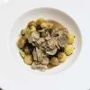 Sfere di patate, aglio nero, Grana Padano Dop Riserva, riccio di mare e tartufo di Cristina Bowerman