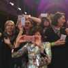 IPhones sometimes take pictures out of focus, especially when the person taking the picture is in a rush to depict the wives of the awarded chefs, including, in the middle, Lara Gilmore, Mrs Bottura