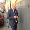 By chance, Giuseppe Palmieri, maître and sommelier, appears from the grey door