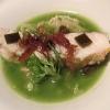 Branzino al vapore con calamari mignon brasati in cima e alga combu, brodo di alghe, granchio e kimchi bianco