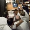 Nicola Farinetti e la foto al contrario. Di spalle si riconoscono Ugo Alciati, Massimo Bottura
