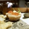 Crust of steamed bread, Arctic char roe, mountain butter. Appetizers are paired with dolomitic tea aromatized with porcini