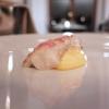 Astice alla brace con carciofo arrosto, zabaione al limone, sfere di mela verde, gin e sedano