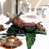 Grilled pigeon, black cabbage and frisse