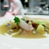 """Brodetto """"vivace"""" dell'Adriatico ai frutti di mare. Questi ultimi (garusoli, fasolari, cozze, vongole, cappelunghe) sono preparati recuperando l'idea tradizionale di ricetta """"alla cappuccina""""; quindi pepe, vino bianco, brodo di pesce, poi limone sciroppato a freddo, scalognetti, acqua di pomodoro, più alga kombu per una nota affumicata. Altro piatto riuscitissimo"""