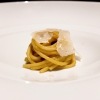 Spaghettoni, courgette flowers, Parmigiano: the pasta is made with bronze moulds, the courgette flowers are in the shape of a cream. The Parmigiano is matured 36 months. Strong acidity, an unexpected first course