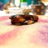 Anguilla laccata all'aceto balsamico di Modena, salsa di carpione, polvere di verdure disidratate