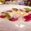Raw scallops and beetroots, with lime zest, leaves of radish and sauce of scallop coral