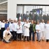 In foto,Roberta Garibaldi(in verde), direttore scientifico diEast Lombardy, circondata dal folto gruppo di chef e produttori che ha animato l'appuntamento di sabato a pranzo