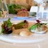 Calamari al testo, polveri mediterranee, bitto dop e tartufo nero: uno dei piatti più riusciti è firmato Stefano Ciotti