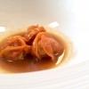Tortelli di ossobuco, crema di pomodoro affumicato e acqua di friggitelli