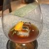 Finale salato a base di piccione: qui il suo consommé con armagnac, dragoncello e arancia