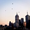 Hot-air balloons flying over Melbourne at dawn on Wednesday 5th April 2017