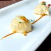 Raviolo in coppia cottura (effetto cruncy alla base) con lonza, frittata di uova ederba cipollina cinese jiu cai (Allium tuberosum)