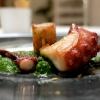 Polpo grigliato, terrina di maiale, tenerumi di zucchina e salsa acida