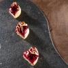 Mini-pizzeconvellutata di rapa rossa, topinambur,hummus di ceci, rapa fermentata, scorza di limone pastorizzata e noce pecan