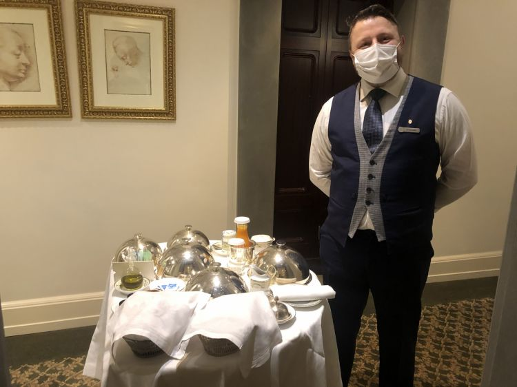 Emanueleready to serve breakfast in the room