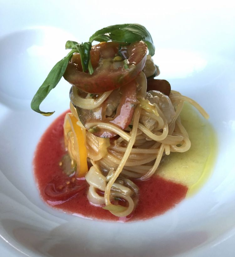 Cold spaghetti with raw fish with tomato and basil