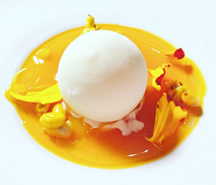 Sphere of yogurt with calamansi and sauce of sea buckthorn
