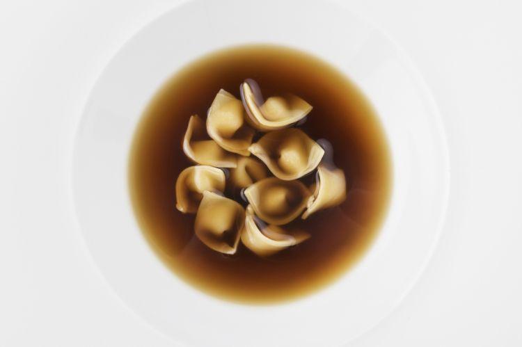 Fresh ravioli filled with almond in spicy mushroom infusion (2012)