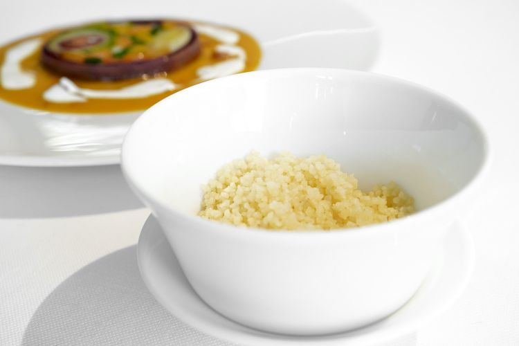 Lemon and cinnamon couscous is served with the tajine
