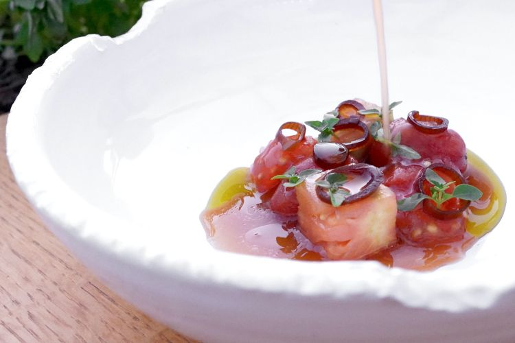 """This Tomato salad (macerated beefsteak tomatoes, shallot with soy, tomato seeds, date tomatoes cooked in ash, oil of tomato stems, tomato water) is spectacular. A masterful interpretation of the Mediterranean essence, paired with a sort of """"cordial"""" with bananas and mint, very light and rather sweet"""