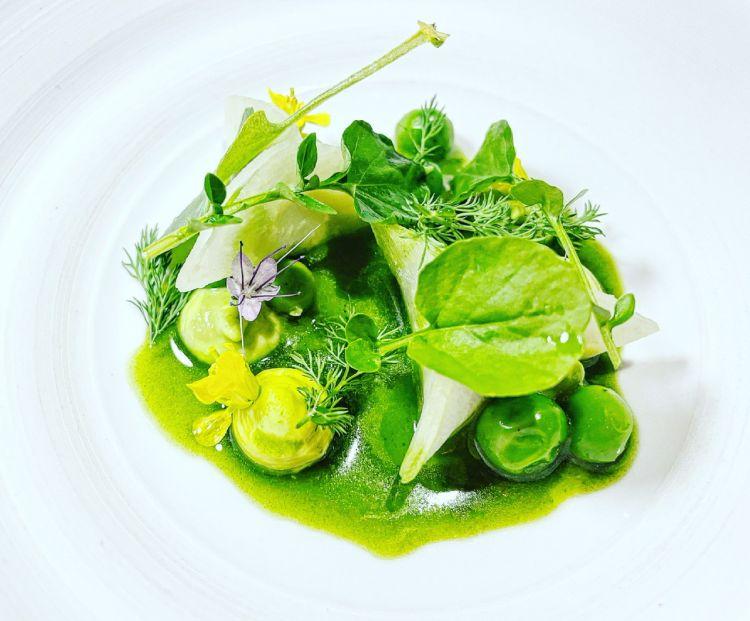 Cream of peas and ravioli with watercress