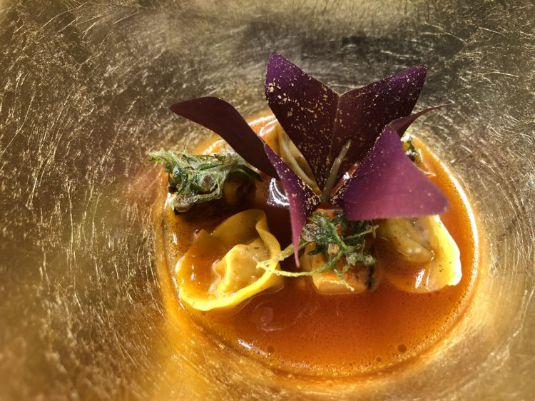 Tomato broth, dumpling with chicken fat, crispy coriander. Tomato is an essential ingredient in Himanshu's cuisine. The supplier? An incredible Organic Farmthat thrives in the desert outside Dubai