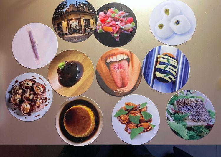 Il nuovo menu di fun dining dell'Osteria Billis viene presentato su dei sottobicchieri fotografici giocosi