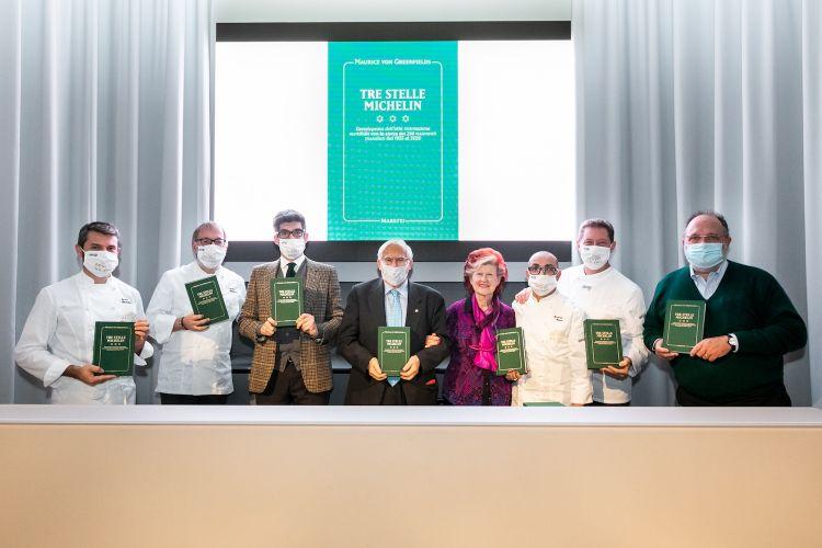 Foto di gruppo alla conferenza stampa di presentazione del libro: da sinistra Bartolini, Niederkofler, l'editore Maretti, l'autore Campiverdi, Féolde, Monco, Cerea, Marchi