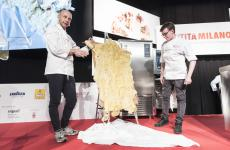 Riccardo Camanini, his sous Gilles Fornoni and sbernia [sheep's meat] covered in beeswax at Identità Milano 2018 (photo Brambilla-Serrani)