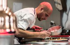 Giovanni Passerini at work in the kitchen of his restaurant in Paris