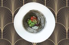 """Seppia, fave e cipolla rossa, uno dei piatti che compone il""""Menu del Doge"""", degustazione storico studiato daDaniele Turco, chef del Club Del Doge, il ristorante del Gritti Palacedi Venezia"""