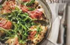 A truly romagnola pizza at Ossteria in Savignano sul Rubicone, in the province of Forlì-Cesena (via Battisti 23/d. Tel. +39 0541 944939, ossteriasavignano.com): Raw ham, squacquerone cheese and rocket