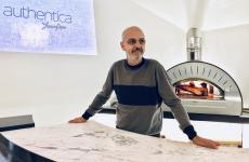 Franco Pepe in front of Authentica's heart, the oven that can bake pizzas for a maximum of 10 guests in the private room opened informally on the 7th December