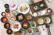 A picture of the very many small and big courses served during a meal at Balwoo Gongyang, in Seoul
